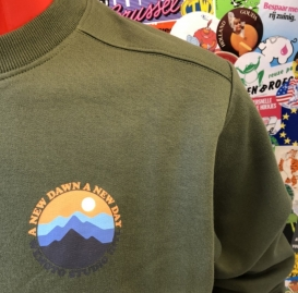 A New Dawn olive crew neck sweater